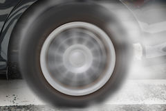 Car wheel drifting and smoking on track dark edition stock image