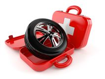 Car wheel with first aid kit. Isolated on white background Stock Photography