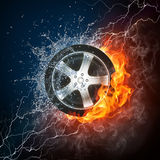 Car Wheel in Flame and Water. Car Wheel in Fire and Water. Computer Design Royalty Free Stock Photo