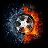 Car Wheel in Flame and Water. Car Wheel in Fire and Water Isolated On Black Background Royalty Free Stock Image