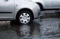 Car wheel in flood Royalty Free Stock Photos