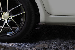 Car wheel On the gravel road Stock Photography