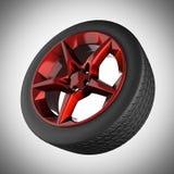 Car wheel on gray background Royalty Free Stock Photo