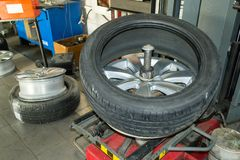 Car wheel half taken from the disk to perform tire mounting and stock photo