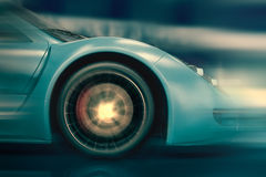 Car wheel in motion blur at fast driving Royalty Free Stock Photography