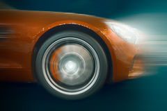 Car wheel in motion blur at speed driving Royalty Free Stock Photo