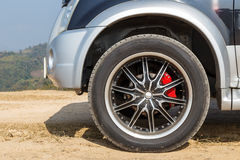 Car wheel on mountain Stock Photos