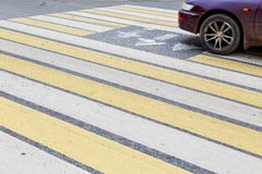 Car wheel at a pedestrian crossing. City stock images