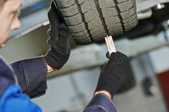 Car wheel protector measurement Stock Photography