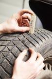 Car wheel protector measurement Stock Photos