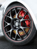 Car wheel with red-hot brakes Stock Photos