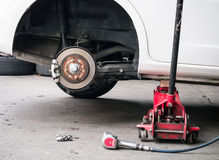 Car wheel removed out Stock Images