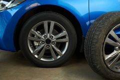 Car wheel repair service. Replaced damaged car wheel Stock Image