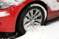 Car wheel in snow. Car wheel and tyre stuck having problems moving in a snow blizzard Royalty Free Stock Images