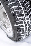 Car wheel in snow Royalty Free Stock Photo