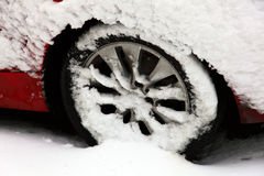 Car wheel in a snow blizzard Stock Image