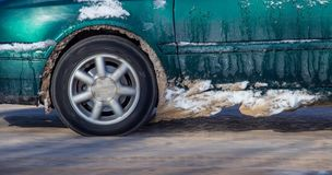 Car wheel in the snow in winter.  royalty free stock photography