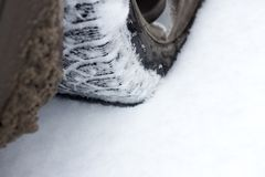 Car wheel on snowy road . Car wheel on snowy road Royalty Free Stock Images