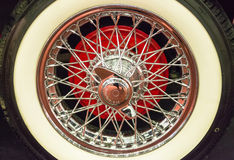 Car wheel steel spokes. Vintage car wheel with custom tire and steel chromed spokes, detail stock image