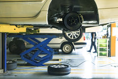 Car wheel suspension and brake system maintenance in auto serv. Ice before long journey royalty free stock images