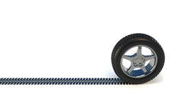 Car wheel tire. 3d render illustration of a car wheel making track over white Royalty Free Stock Photography
