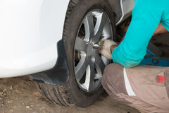 Car wheel tire replacement of technician Stock Photography