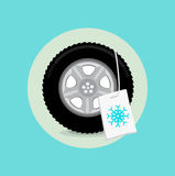 Car wheel/tire with winter sign flat design Royalty Free Stock Images