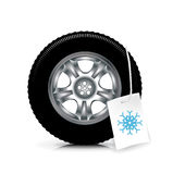 Car wheel/tire with winter sign isolated on white Royalty Free Stock Photos