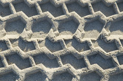 Car wheel track on the sand in the natural environment Stock Images