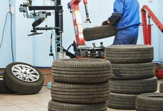 Car wheel tyre fitting or replacement Royalty Free Stock Image