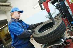 Car wheel tyre fitting or replacement Royalty Free Stock Photos