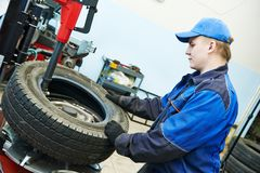 Car wheel tyre fitting or replacement Royalty Free Stock Photo