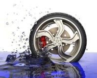 Car wheel with water splash Royalty Free Stock Photos