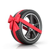 Car wheel wrap a red ribbon with a bow. On a white background Stock Images
