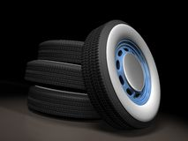 Car Wheels. 3D render of a car wheels over a black background Stock Images
