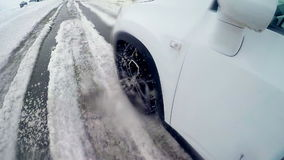 Car wheels driving through heavy snow. Slow motion. On board camera. stock video footage