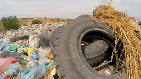 Car Wheels Among Garbage Dumped Into Heap At stock video footage