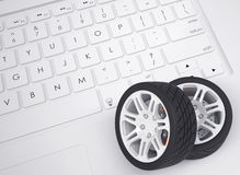 Car wheels on the keyboard Stock Image