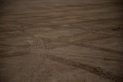 Car wheels marks on sand stock photos