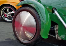 Old and new car wheels Stock Image