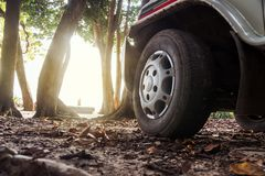 Car wheels on a road. Off-road tire. Stock Image