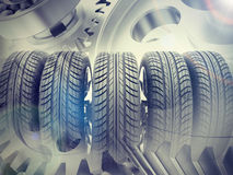 Car wheels set on abstract watchwork background Royalty Free Stock Photo