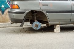 Car without wheels stealing theft transport. Street fixing stock image