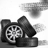 Car wheels and tire tracks Royalty Free Stock Photo