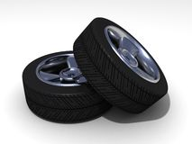 Car wheels on white surface Stock Photos