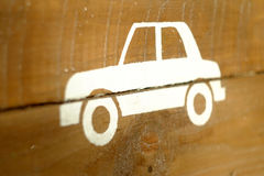 Car. White stencil of a car on a wooden background Stock Photo