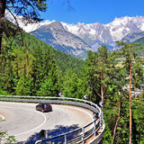 Car on the winding road in mountains Royalty Free Stock Photos