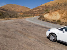 Car on a winding road in South Africa. Car on a panoramic winding road in the mountains of South Africa Royalty Free Stock Photography