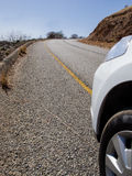 Car on a winding road in South Africa. Car on a panoramic winding road in the mountains of South Africa Royalty Free Stock Photo