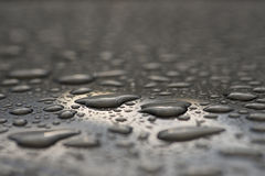 Car window after rain. Macro of a car window covered with water drops stock photo